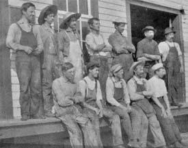 Eldora workmen in front of building