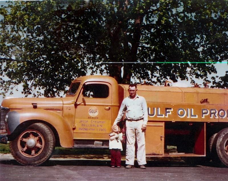 Jesse Creamers Oil Truck with man and small child standing alongside it