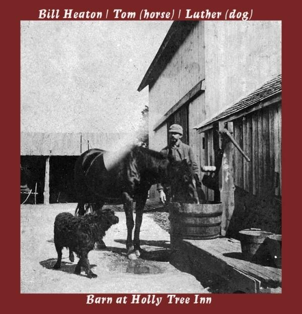 Holly Tree Inn barn with a man watering a horse and a dog by them
