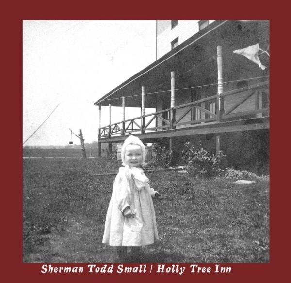 Toddler named as Sherman Todd Small on grass in front of Holly Tree Inn