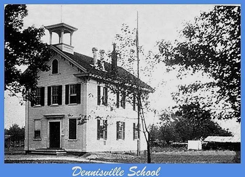 Dennisville School with trees and a building behind it