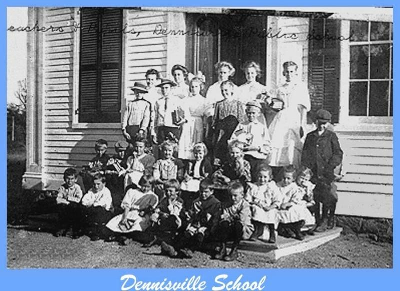 Students pose on step in front of the Dennisville School