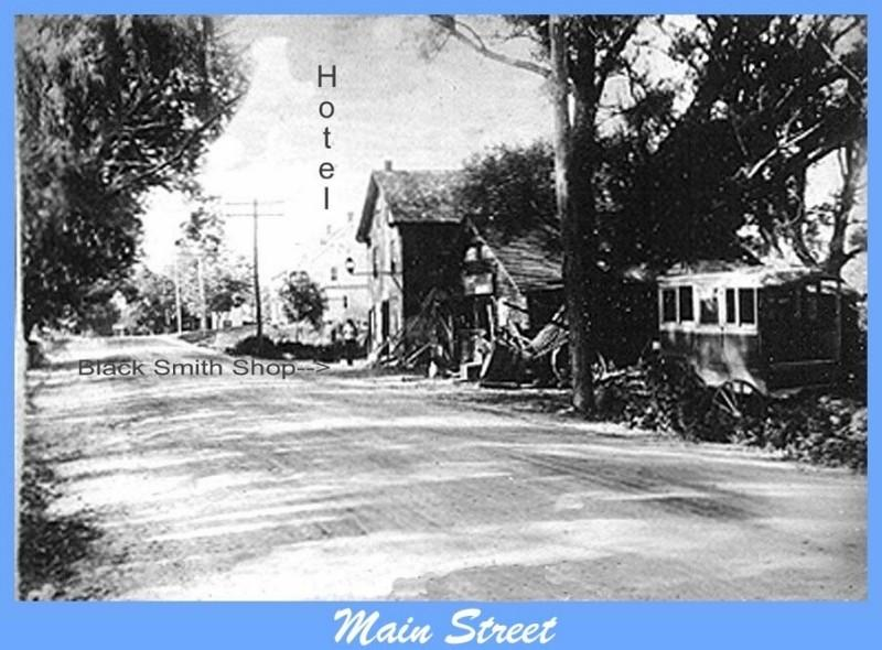 Main Street Dennisville with the Hotel, Blacksmith and carriages