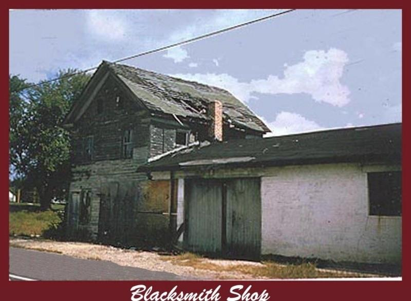 More modern colored photo of the Blacksmith Shop in disrepair