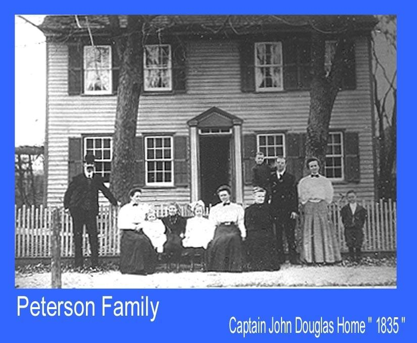 Captain John Douglas Home with people posing in front