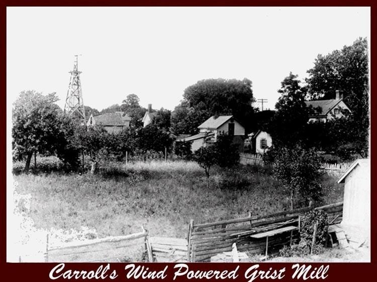 Carrolls Grist Mill with trees and a tower