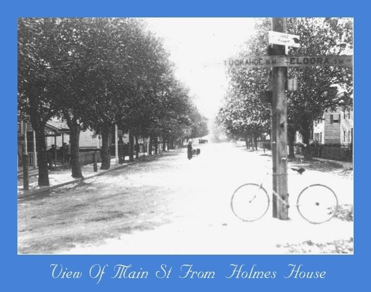 Main Street Dennisville with a bicycle and Tuckahoe and Eldora street sign