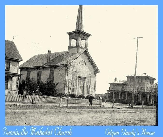 Dennisville Methodist church with a man walking on sidewalk in front of it
