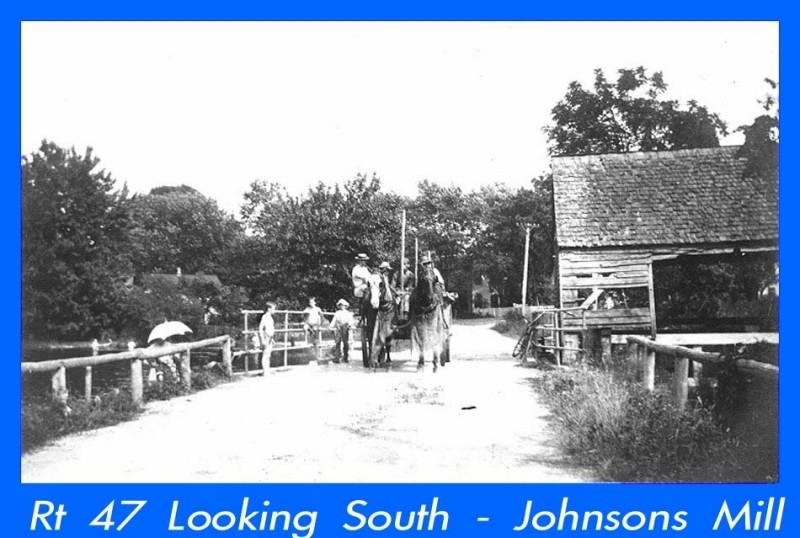 Johnsons Mill with horses, carriage and people on the road in front