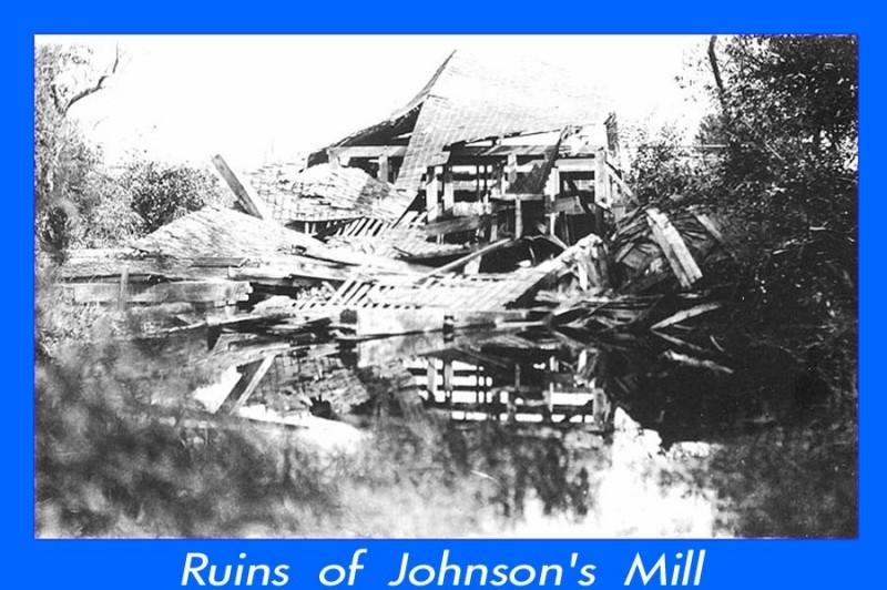 The remain of Johnsons Mill in a heep of wood and metal roofing