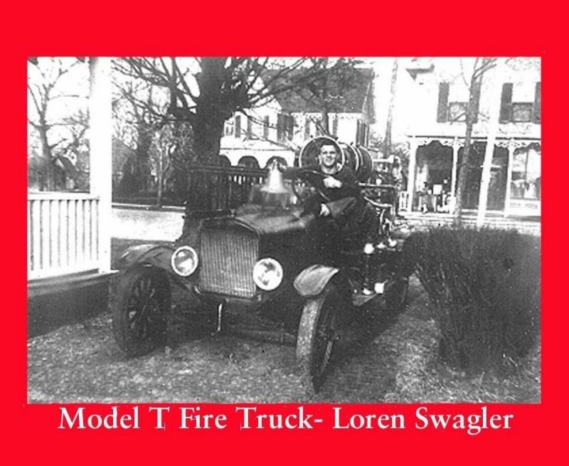 Man sitting in a Model T fire truck
