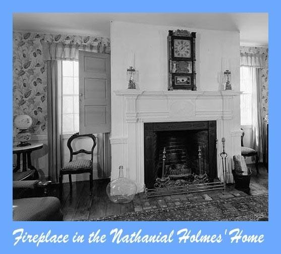 Living room fireplace with large mantle clock in the Nathaniel Holmes home
