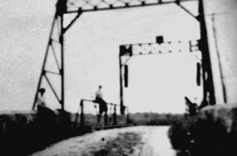 West Creek Bridge with people sitting on rails