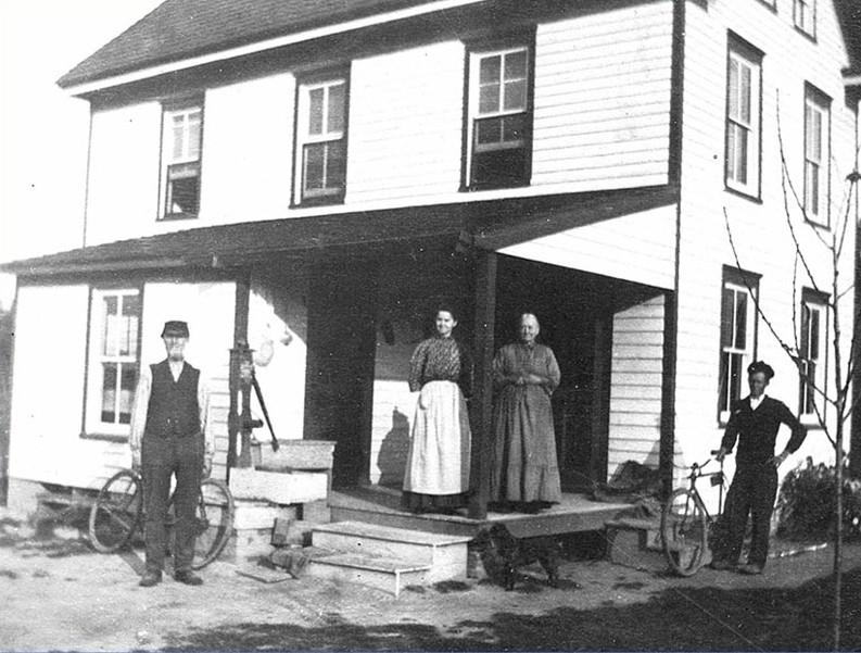 Chambers family posing in front of their house