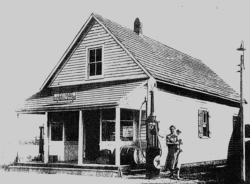 Levi & Lena Hands General Store with gas pump and woman holding child