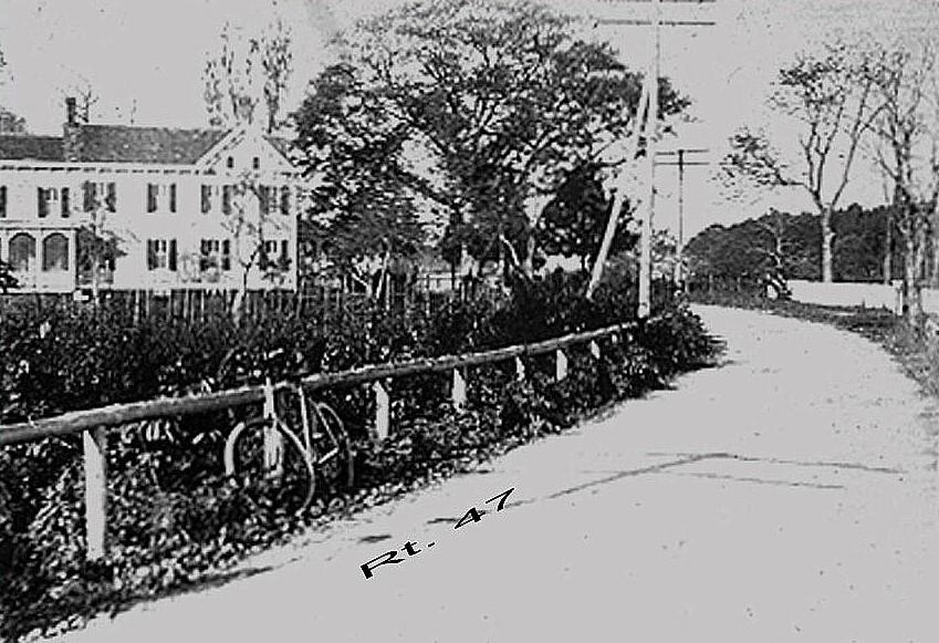 Grainy photo of Jeremiah Nixon house and road