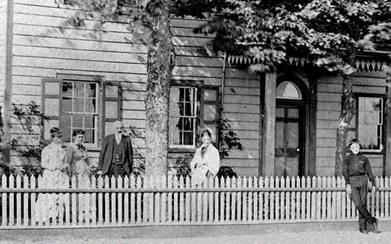 William Townsend standig behind their white picket fence