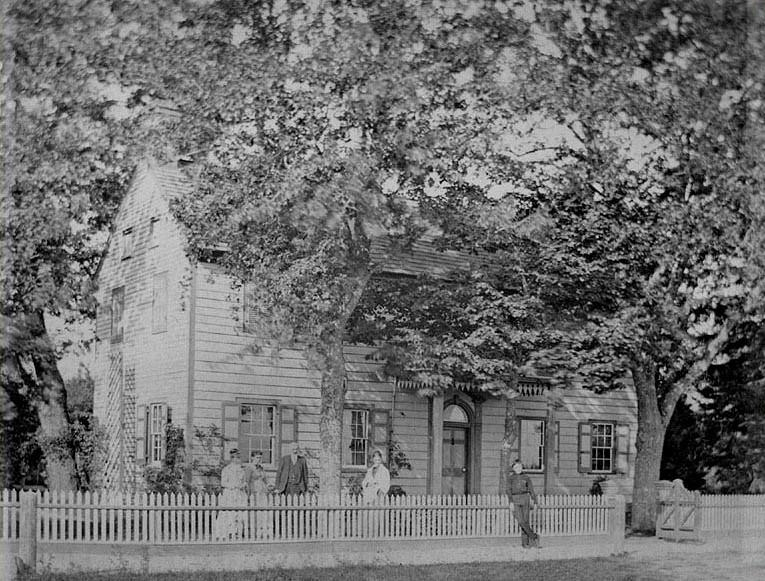 William Townsend family standing in front of their house