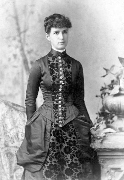 Nicely dressed woman identified as Fannie Holmes