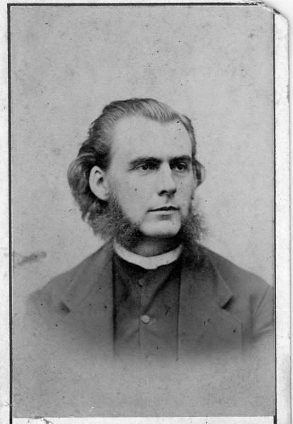 Man with mutton chops identified as Samuel Carroll
