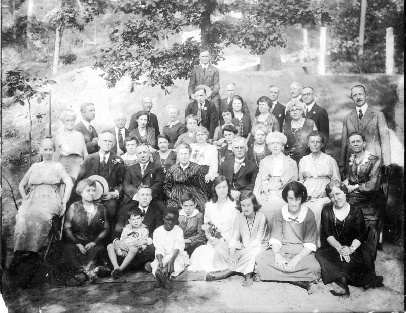 Large group photo of the Carroll Family taken outdoors