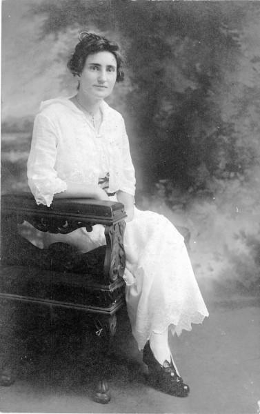 Mae Scull wearing a laced white dress