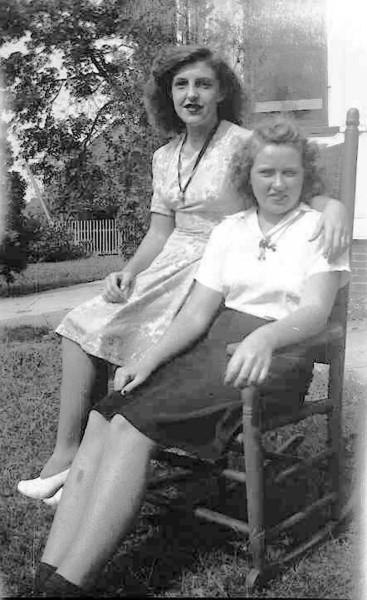 Doris Robinson & Sara Brewer sitting outside on rocking chair