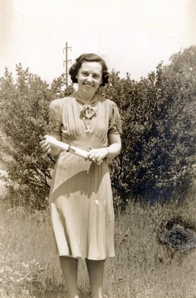 Woman named Helen Meerwald standing outdoors holding certicate