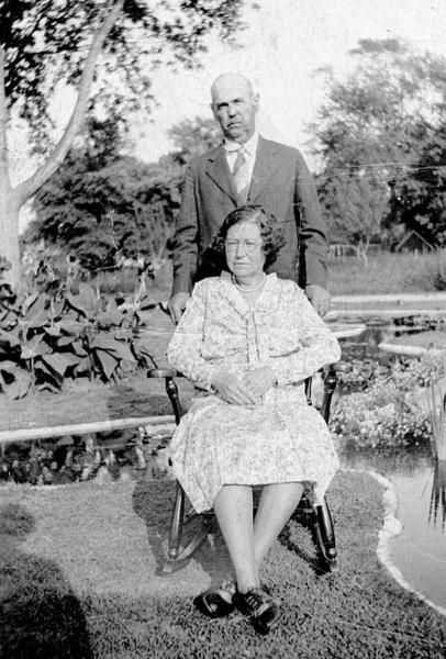 Mr. and Mrs. AJ Meerwald posing in garden