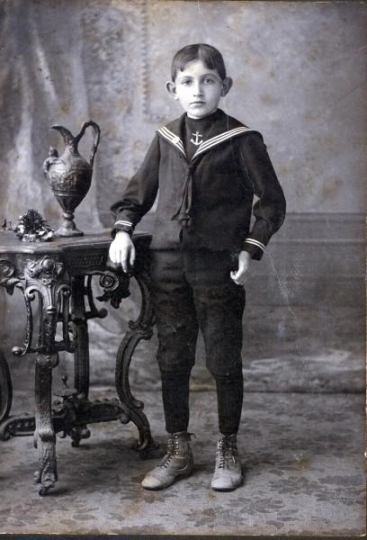 Boy wearing sailor outfit named Abraham Eisenberg