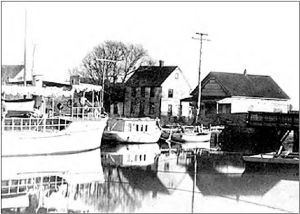 Dennis Creek Landing with boats and buildings circa 1915