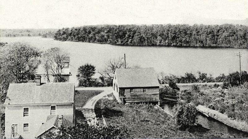 House and barn with Magnolia Lake in the background