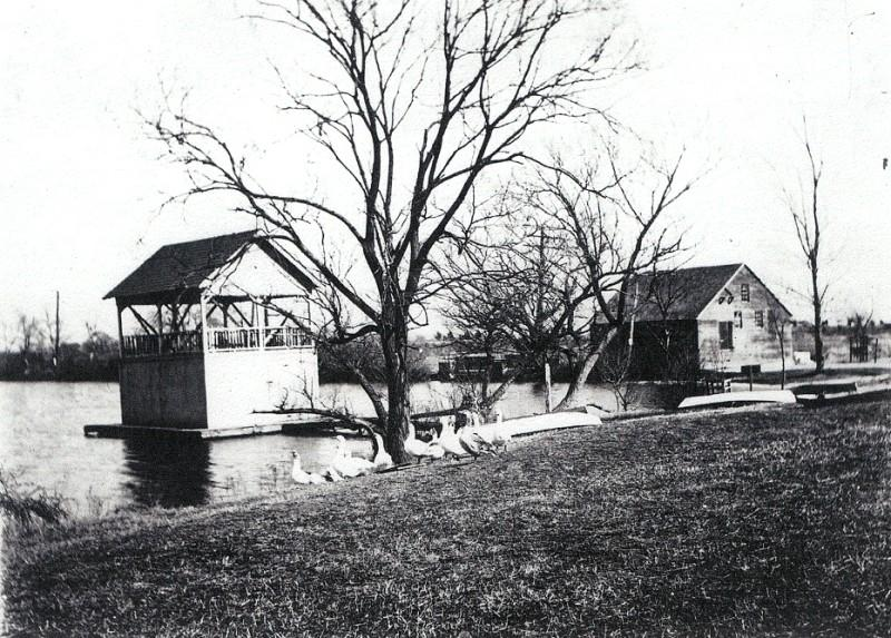 Boat house on Magnolia Lake with geese on the shore