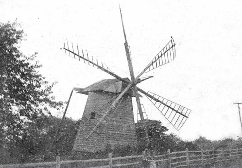 Old windmill with wood fence in front