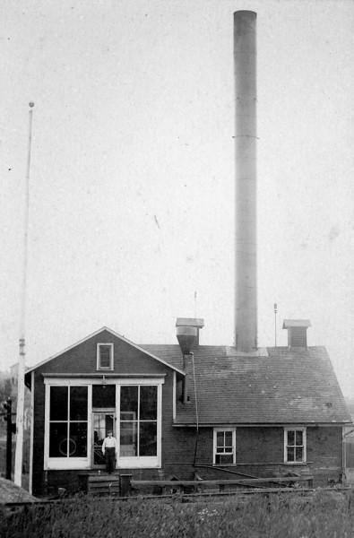 Building in Ocean View with smokestack