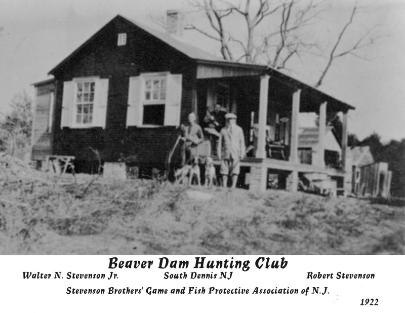 Beaver Dam Hunting Club in 1922 with hunters and dogs on porch