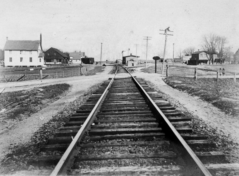 Railroad tracks with lumber yard and other buildings