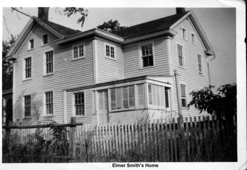 Elmer Smith home with a picket fence