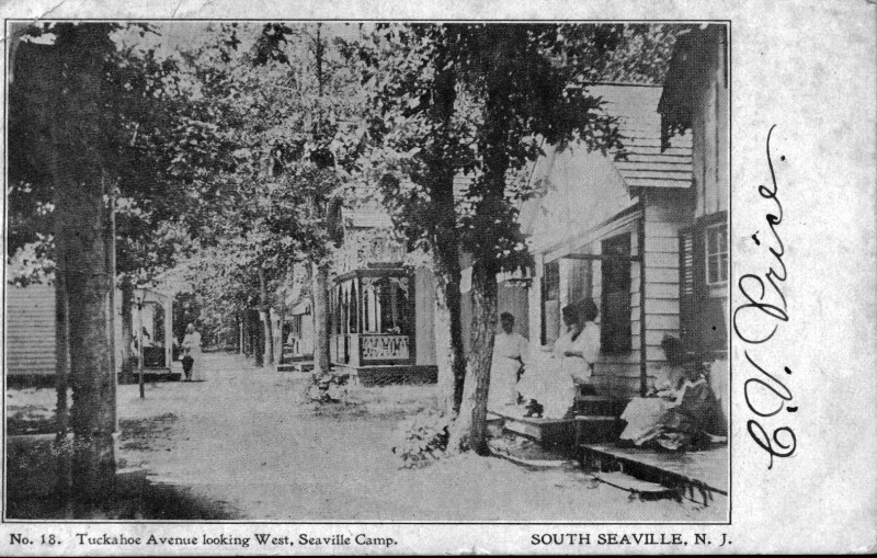 Seaville postcard showing houses with families on porch stoops