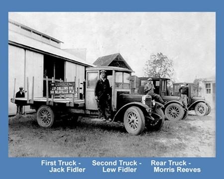 Antique trucks parked in alongside a building