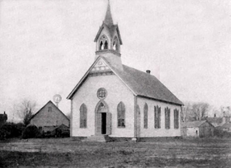 Methodist church with farm in background