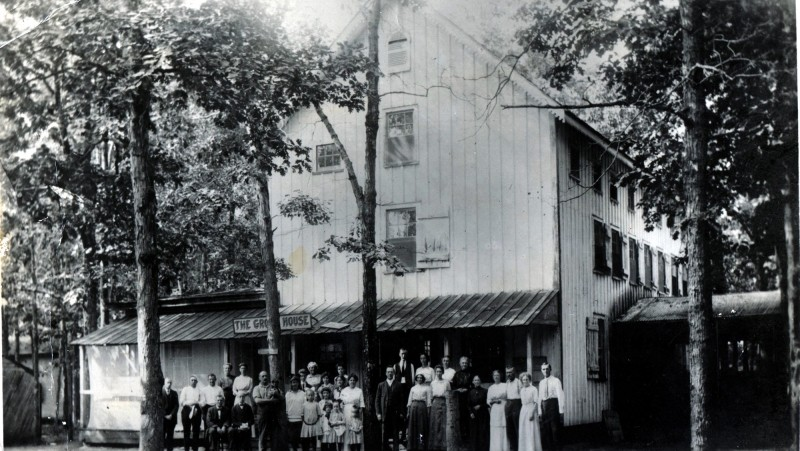 South Seaville Camp with people standing in front of building
