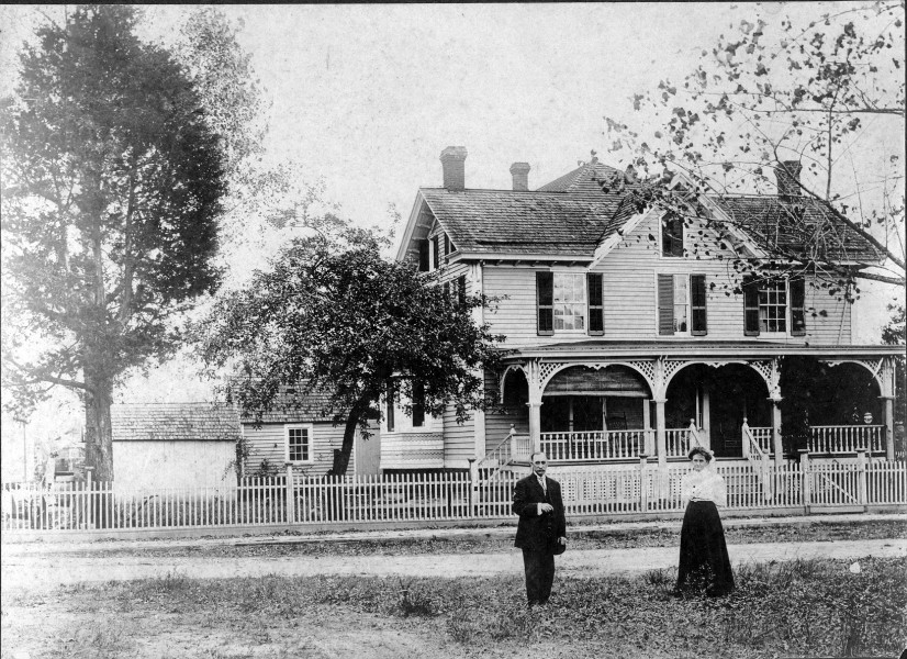 Blenco House with man and woman standing in front
