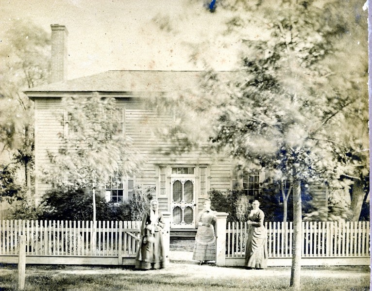 Three women standing in front of a South Seaville house