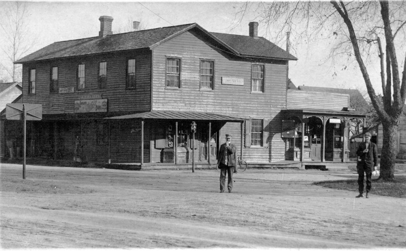 Way's Store with two men standing in street in front of it
