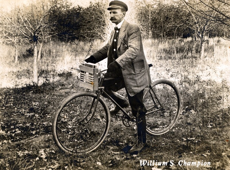 William S. Champion on a bicycle