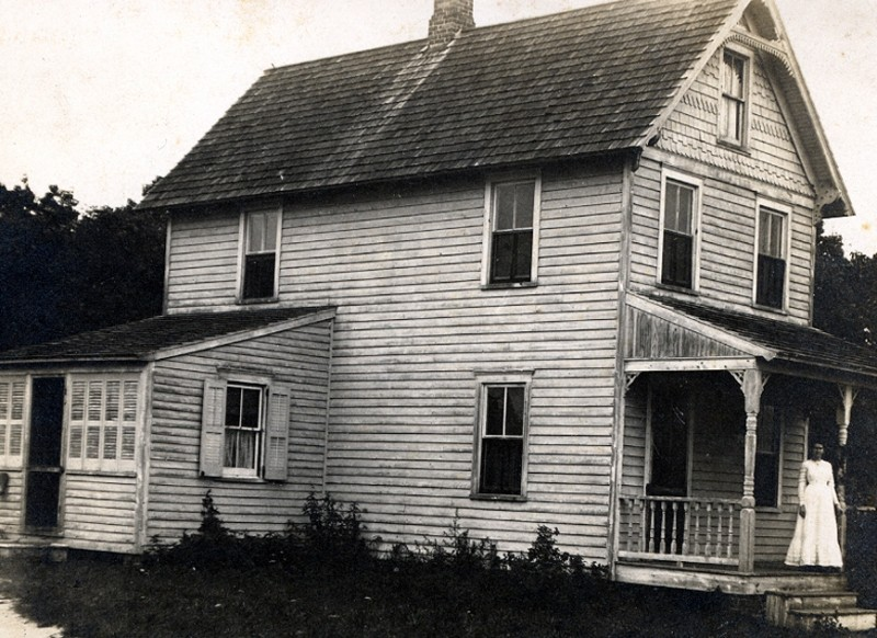 House with a woman standing on porche