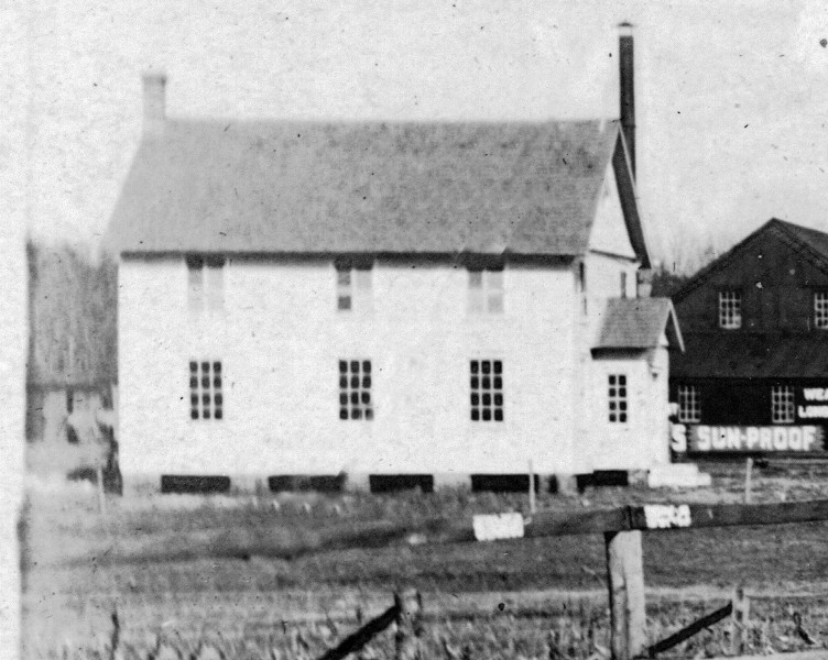 Old church with barn behind it