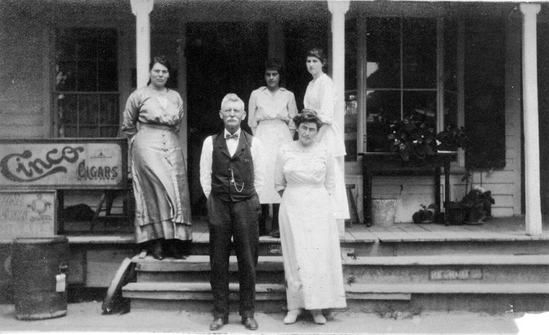Payne family standing on steps of their store