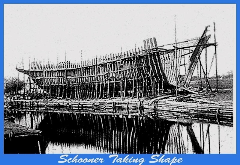 Schooner under construction that is being framed but taking shape